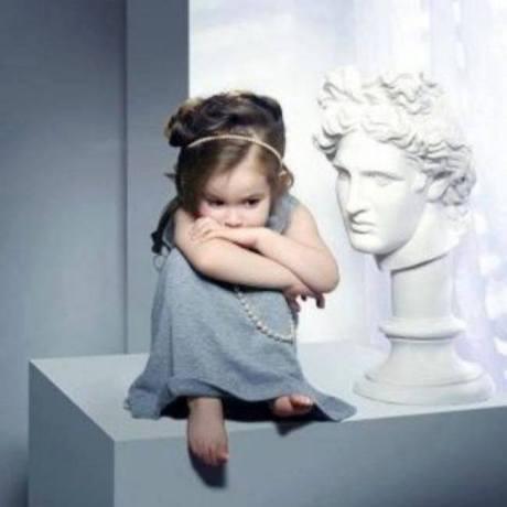 child ancient greek statue